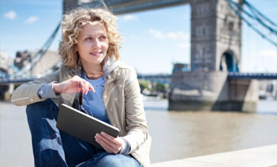 Student studying english on her ipad at London Bridge