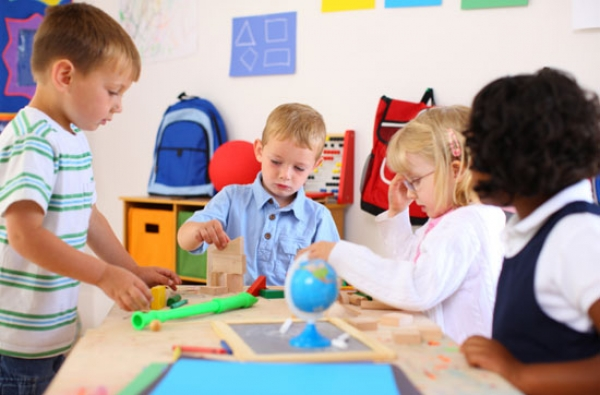 Children learning using the Montessori Method